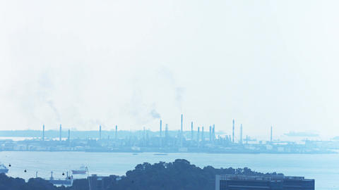 Extreme Zoom of an Industrial Cityscape with Smoke Stacks. UltraHD video Footage