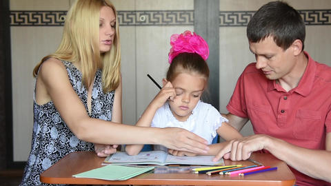 Parents show a child that she made mistakes doing homework Footage