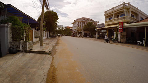 Tourist's perspective walking against light traffic on city street in Siem Reap Live Action
