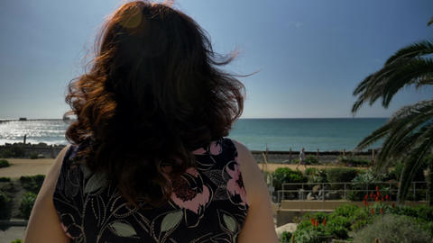Happy woman back view in Linda Lane Park in San Clemente California Live Action