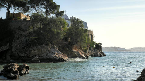 Rocky point with private villas above calm azure sea on the Balearic island Live Action