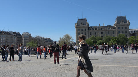 People at the Square of Notre Dame in Paris Live Action
