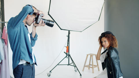 Beautiful Afro-American lady posing for camera in advertising agency studio Live Action