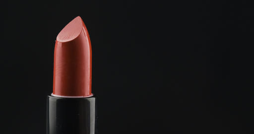 Close-up of opening lipstick. Opening red lipstick isolated on black Live Action