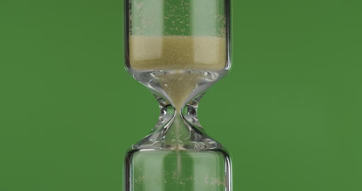 Sand moves through hourglass. Close-up, sand Live Action