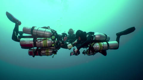 technical scuba divers doing drills Live Action