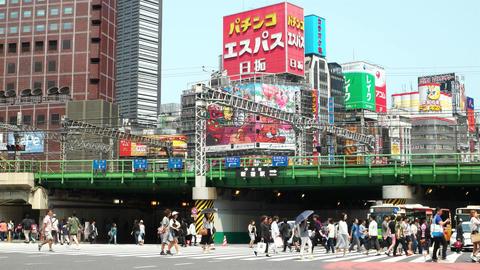 Tokyo, Japan - May 2016: People on crosswalk with colorful billboards in backgro ビデオ