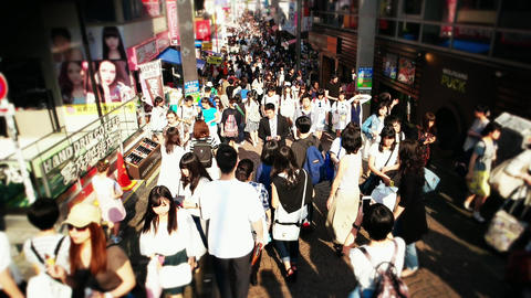 Tokyo - May 2016: Crowded street view from above. Harajuku shopping area. Slow m Footage