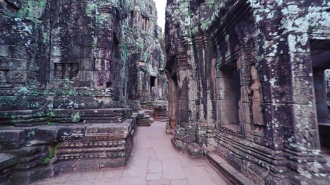 Strolling on an Ancient Pathway at Bayon Temple in Cambodia. Video 4k Live Action