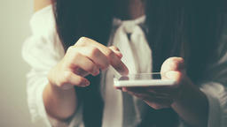 young Asian woman using smartphone, closeup portrait Footage