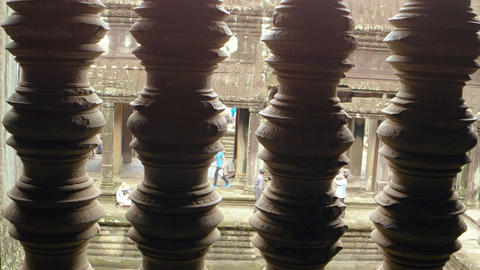 Unique perspective shot through ornate railing of tourists at Angkor Wat Footage
