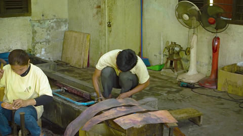 Local metalwork artists shaping brass sheeting into beautiful creations Live Action