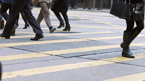 Feet and legs of pedestrians crossing busy city street in Hong Kong Footage