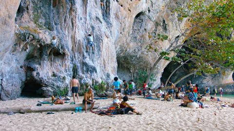 Popular climbers area on beach where tourists can climp up the rock cliff Footage