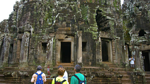 Tourists visiting Bayon Temple. an ancient Khmer religious site. Cambodia Footage