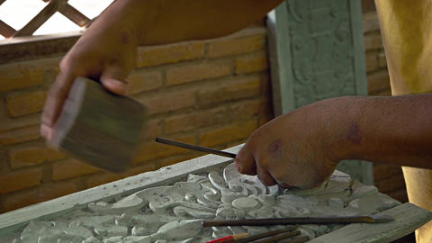 Cambodian Artisan Carves Intricate. ornate Details into Stone Slab. UHD video Live Action