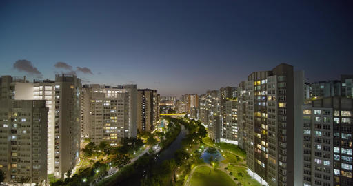 Dense high rise modern apartments in Punggol district Singapore at night Live Action