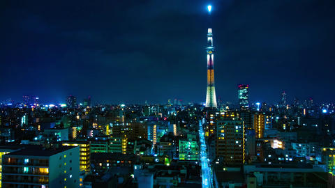 A night timelapse of Tokyo sky tree at the urban city in Tokyo wide shot tilt Live Action