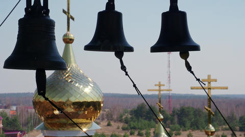Many ringing church bells in the church bell tower Live Action