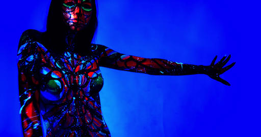 Colorful patterns and bright paint on the body of a woman slow dancing, 4k Live Action