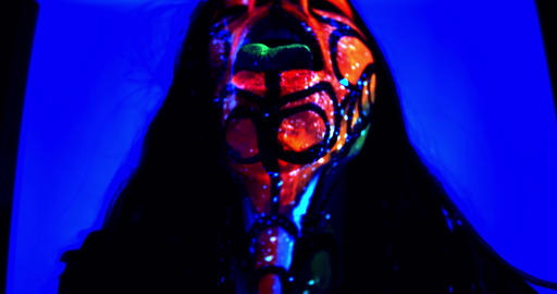Woman with glowing body art is showing her glowing green… Stock Video Footage
