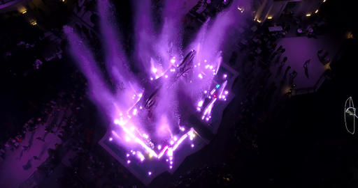 Stunning water show with water bursting in the air with colorful lighting, 4k Live Action
