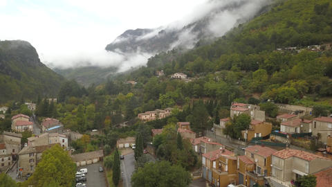 Aerial footage of a mountain village with the stunning mountains with clouds, 4k Live Action