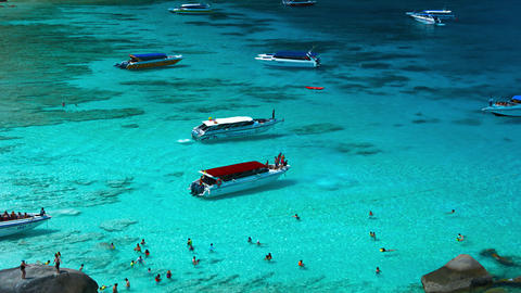 People and tourist modern speed boats in idealistic tropical blue sea lagoon Footage