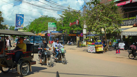 Motor rickshaws and other vehicles on a typical city street. UHD video Live Action
