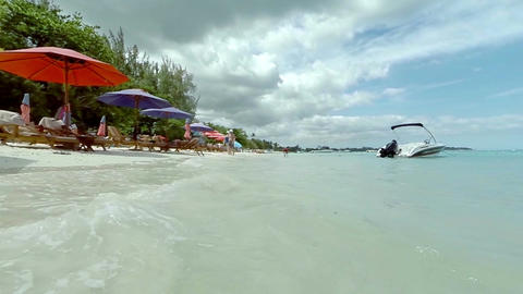 View of a beach and crystal clear waters on a sunny day, Mauritius , Indian ocea Live Action