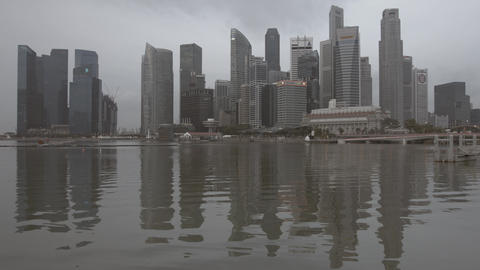 Marina Bay water and downtown modern glass skyscrapers buildings Footage