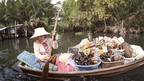 Local vendor selling seafood from a river canoe. Video 3840x2160 Footage