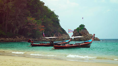Traditional Long Tail Boats at a Tourist Beach in Thailand. Video 4k Footage