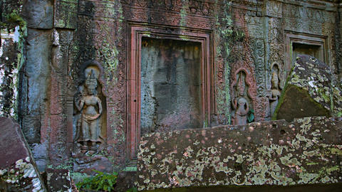 Ancient Relief Sculptures in the Walls of a Temple Ruin. Video 4k Live Action