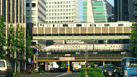Tokyo - May 2016: Street view with trains passing by. 4K resolution Footage