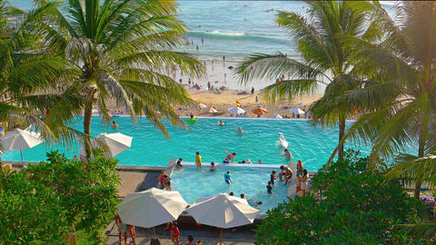 Hotel with big public swimming pool on the coast. Video UltraHD Footage