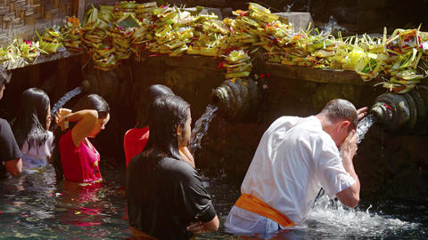 Tirta Empul temple. Holy springs. Bathe the locals and Europeans. Video UltraHD Footage