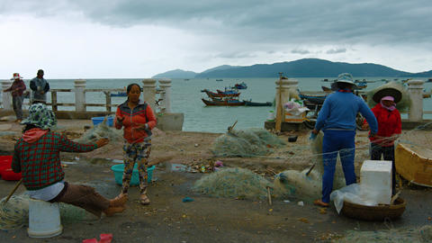 Nha Trang locals straightening their fishing nets for the daily expedition Footage