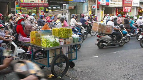 Traffic on the ordinary street. Fruit seller Trolley. Video UltraHD Footage