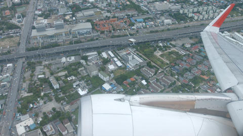 Urban center. from window of airliner. with the plane's wing and engine Footage