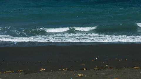 Indonesia. Bali. Beach with black sand and garbage from religious ceremonies Footage