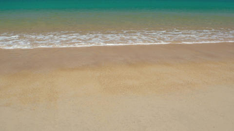 Gentle Waves Lapping at the Sand on Tropical Beach. UltraHD video Footage