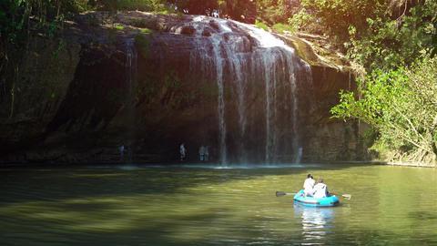 Tourists in rubber raft drift at base of Prenn Waterfall near Dalat. Vietnam Footage