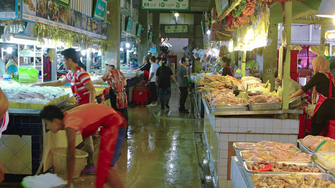 Fresh poultry and seafood at an indoor public market in Phuket Footage