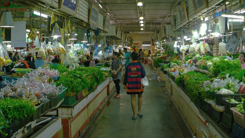 Customers buying fresh vegetables at an indoor public... Stock Video Footage
