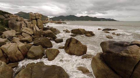 Ocean waves splash over the Hon Chong Rocks in Nha Trang Footage