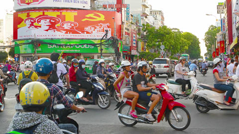 Heavy motorcycle traffic and other vehicles in Ho Chi Minh City. with sound Footage