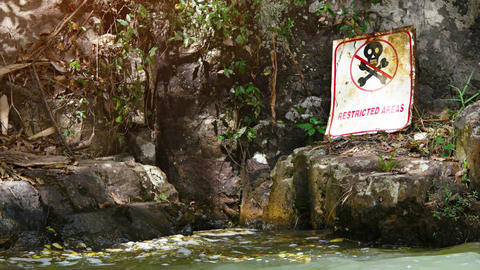 Safety Warning Sign near Waterfall Footage