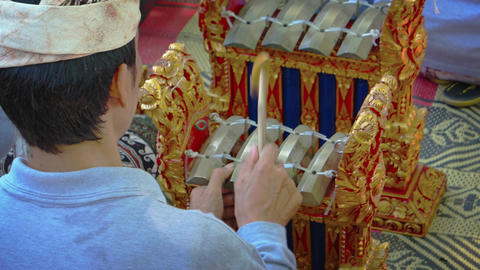 Local musician playing traditional Balinese musical instruments in ensemble Footage
