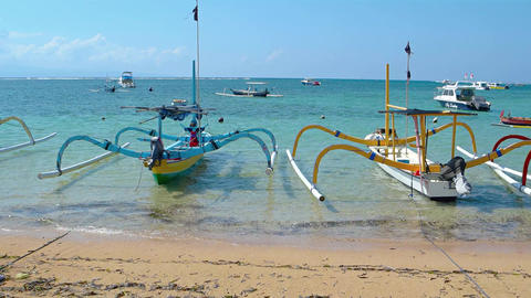Many small boats tied and anchored off popular tourist beach. Sanur. Indonesia Footage